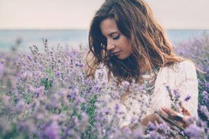 Seraj Header Image Testimonials Page Woman in Lavender Field