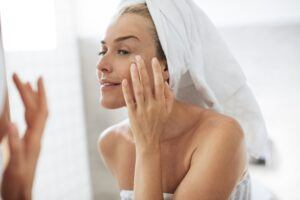 Seraj Say Goodbye To Fine Lines - Woman applying eye cream after shower
