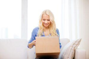 Woman opening box and smiling